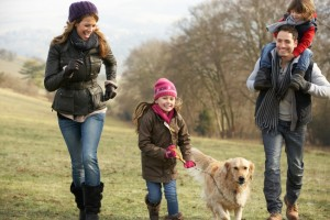 Family and dog on country walk in winter
