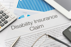 stock-photo-54088332-disability-insurance-claim-form-with-paperwork