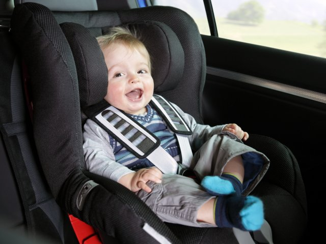 Baby boy in his child safety car seat