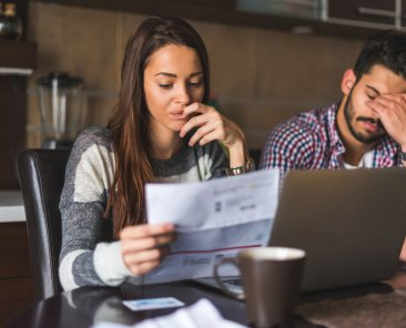 Couple looking at the bills and planning their expenses.